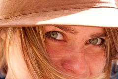 Closeup of green eyes of attractive blonde girl Royalty Free Stock Photos