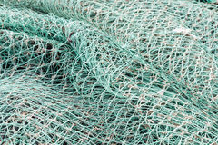 Closeup of green netting. Fishing green nets creates background of ropes and knots Stock Images