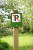Closeup of a green no parking sign.  royalty free stock photos