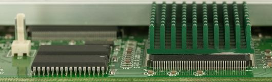 CloseUp green PCB for background. There are chips, radiators, micro resistor, capacity and etc Stock Photo