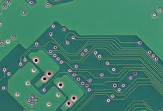 Closeup of Green Printed Circuit Board With Solder Stock Images