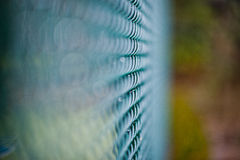 Closeup of green wire mesh fence Stock Photos