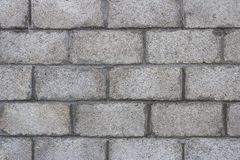 Closeup of grey block wall. stock image