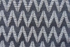 Close view of grey fabric with white zigzags Stock Photos