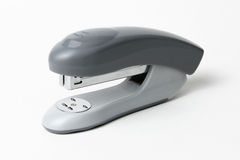 Closeup of a grey office stapler, isolated on white background Stock Photography