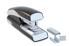 Closeup of a grey office stapler and staples Royalty Free Stock Photos