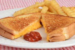 Closeup grilled cheese with ketchup focus on ketch Royalty Free Stock Photo