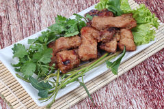 Closeup,Grilled pork with mixed herb served . Stock Photography