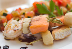 Closeup of grilled salmon and shrimps with vegetab Stock Photography