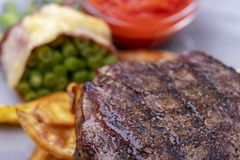 Closeup of grilled steak. With french fries stock images
