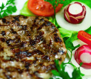 Closeup of grilled steak with fresh vegetable salad Stock Photos