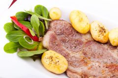 Closeup Of Grilled Steak With New Potatoes Stock Photos