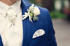 Closeup groom boutonniere Stock Image