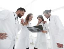 Group of doctors discussing an x-ray. Closeup of a group of doctors discussing an x-ray of the patient after surgery Royalty Free Stock Image