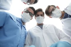 Closeup. a group of doctors in the operating room. The concept of health Stock Photos