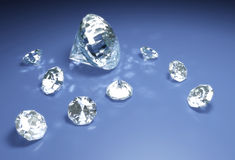 Diamonds on a blue surface Stock Photos
