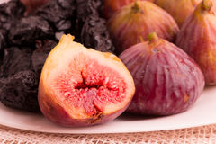 Closeup of group of figs and plums in a white plate Royalty Free Stock Photo