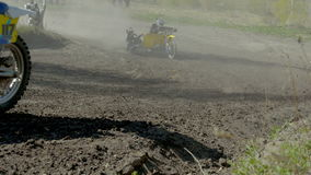 Closeup of group of riders on a motorcycle with a sidecar go on race stock footage