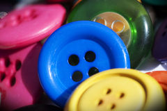Closeup on group on vintage buttons. Closeup on group of vintage buttons. Focus on the blue one in the middle Stock Photo