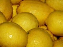 Closeup group of whole fresh lemons background, stock Royalty Free Stock Images
