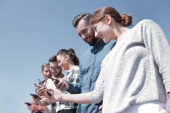 Group of young people with modern gadgets. Closeup of a group of young people with modern gadgets Royalty Free Stock Images