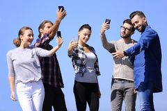 Group of young people taking a selfie. Stock Image