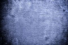 Closeup grunge deep blue metal plate as background texture Royalty Free Stock Images