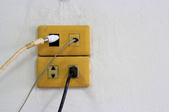 Closeup grunge light switch on dirty  wall Royalty Free Stock Photo