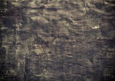 Closeup grunge old black metal plate as background texture Royalty Free Stock Image