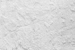 Closeup grunge texture white paint cement wall. royalty free stock image
