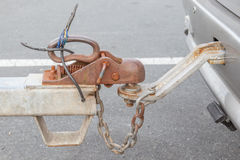 Closeup grungy tow car with connected hook and chain. Royalty Free Stock Photo