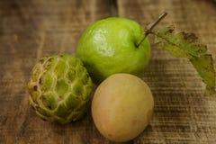 Closeup Guava Sugar-apple Sapodilla on Brown Table Stock Photo