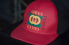Guci red cap in fashion store showroom stock image
