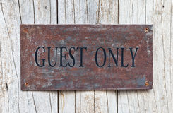 Closeup Guest Only Sign on wooden door Royalty Free Stock Image