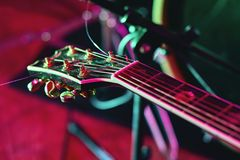 Closeup of guitar fingerboard at concert. In colorful light Royalty Free Stock Image