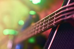 Closeup of guitar fingerboard at concert. In light stock images