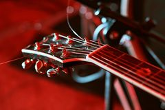 Closeup of guitar fingerboard at concert. In colorful light Stock Photos