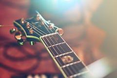 Closeup of guitar fingerboard at concert. In light Stock Image