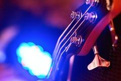 Closeup of guitar fingerboard at concert. In light Stock Photos