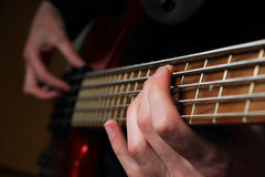 Closeup of guitar and fingers Royalty Free Stock Images