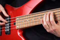 Closeup of guitar and fingers Stock Photos