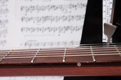 Closeup Guitar Neck, Notes and Metronome Royalty Free Stock Photos