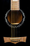Closeup guitar rosette. Black guitar rosette six strings and saddle closeup Stock Photos