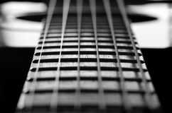 Closeup of Guitar Strings and Frets Stock Images