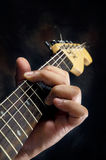 Closeup of guitarist hand playing guitar Stock Images