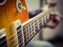 Closeup of guitarist playing electric guitar. Selective focus photo of a guitarist playing their electric guitar Royalty Free Stock Photo