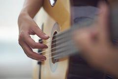 Closeup of a guitarist playing guitar Stock Images
