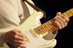 Closeup of guitarist playing in lve concert. Close up of lead guitarist of the group Amalgamation playing in live concert showing the speed of his hands moving royalty free stock photo