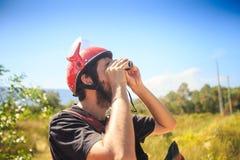Closeup Guy in Helmet Watches Sky with Binocular Stock Images