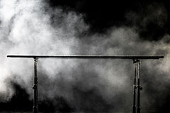 Closeup. Gymnastic parallel bars.  on black background with fog, Royalty Free Stock Image